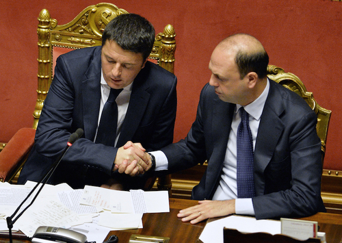 Newly appointed Italian Prime Minister Matteo Renzi (L) is congratulate by Interior Minister Angelino Alfano during a debate for a confidence vote at the Italian Senate  on February 24, 2014 in Rome.Matteo Renzi was to unveil details of his ambitious government programme on Monday as he faced a confidence vote in parliament in a key test of his power to unite warring factions and secure a solid majority. The new premier is expected to present plans for rapidly overhauling the tax system, job market and public administration in his speech to the Senate, which will put his newly-formed cabinet to a confidence vote.    AFP PHOTO / ANDREAS SOLARO        (Photo credit should read ANDREAS SOLARO/AFP/Getty Images)
